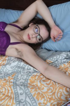 Adorable young brunette in glasses Ember Stone shows us her very hairy pussy