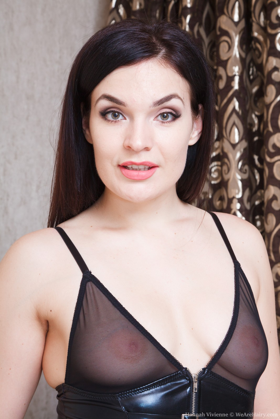 Hot raven haired sexpot Hannah Vivienne takes off her sexy black lingerie to get to her furry hole