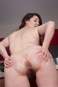 Hairy girl Maxine Holloway undresses and fingers her ass