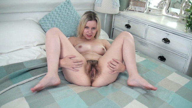Anna Belle strips naked while laying in bed