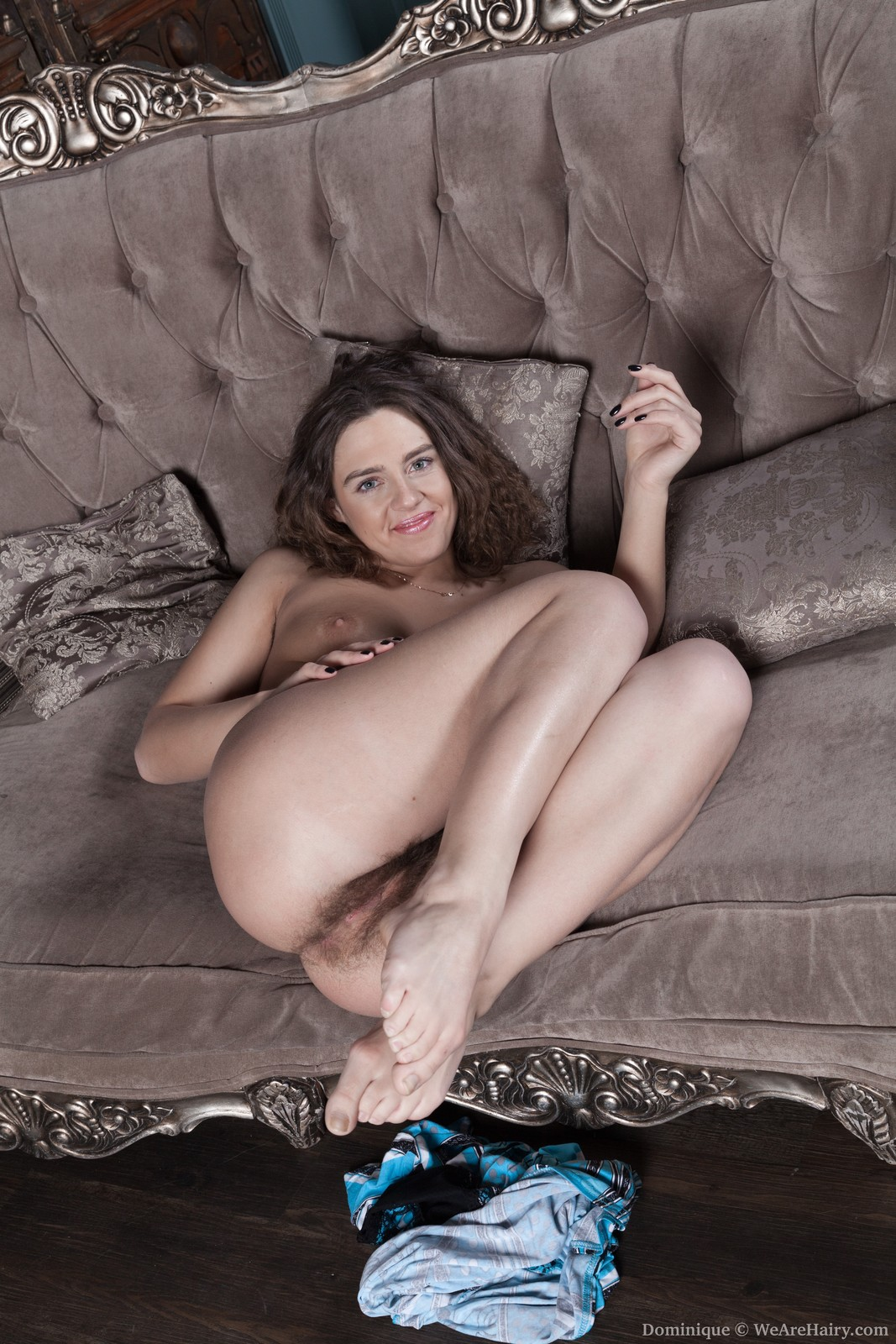 dominique-touches-her-hairy-body-on-a-couch16.jpg