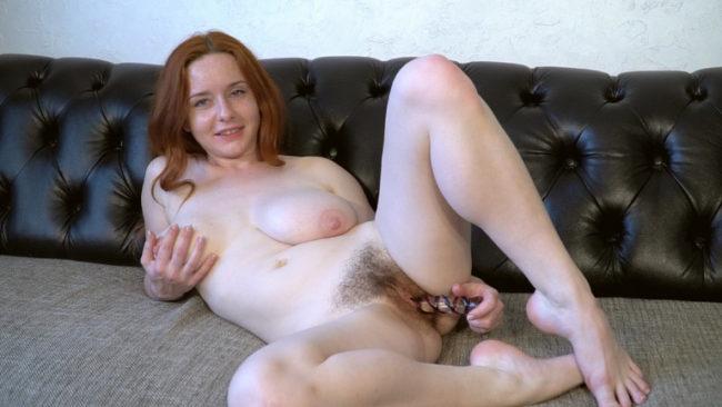 Elouisa masturbates with her glass dildo