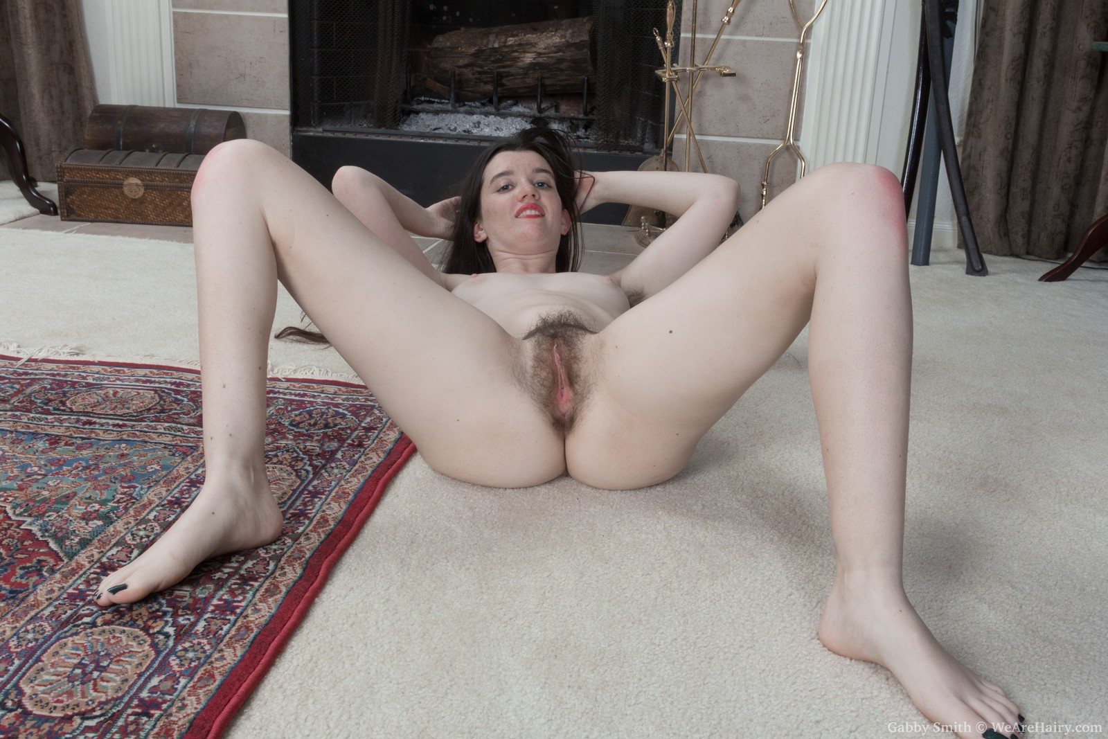 gabby-smith-strips-nude-by-her-fireplace12.jpg