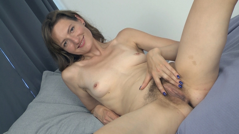 Lulu is in all black stripping naked in bed