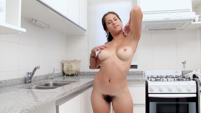 Cute brunette amateur Sally strips naked in the kitchen and spreads her hairy pussy