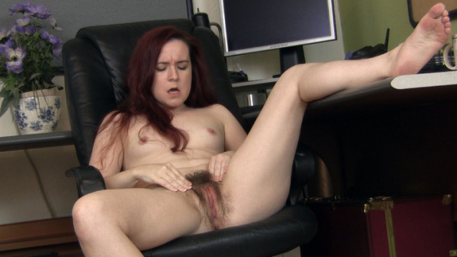 Hairy redhead girl Annabelle Lee gets her pussy off in her office chair