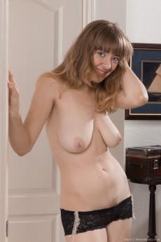 wpid-dani-strips-naked-by-her-white-door8.jpg