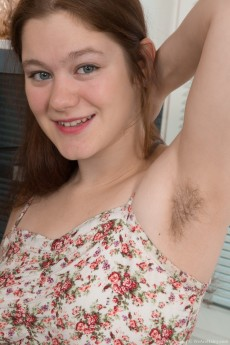 Adorable hairy redhead Elsa Hanemer strips nude and plays with her furry box