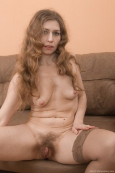 wpid-elza-strips-naked-on-her-brown-couch-looking-sexy9.jpg