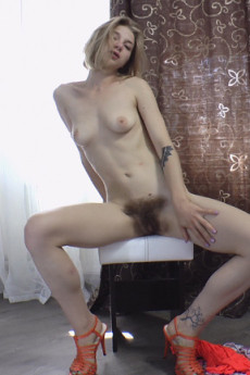 Nasty blonde girl Kristinka gets naked and teases you with her hairy pussy on video