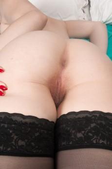 wpid-trillium-strips-naked-from-lingerie-in-her-bed9.jpg